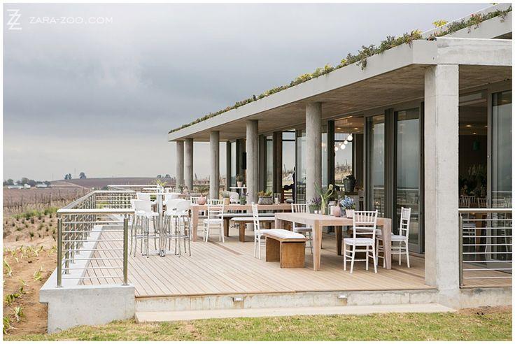 Landtscap wedding venue has spectacular panoramic over the Stellenbosch vineyards and mountains.  It has an eco-roof.  Read the venue review on our website. http://www.zara-zoo.com/blog/zarazoo-top-10-venues-western-cape-best/ #stellenbosch #weddingvenue #landtscap