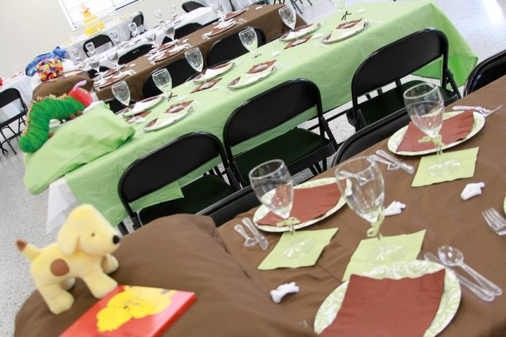 Tables with a flat sheet and pillow case with book and animal to match.