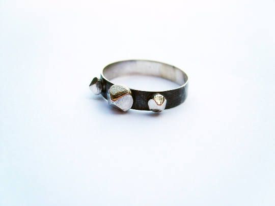 Spikes. handmade oxidized silver ring with shinny hand carved