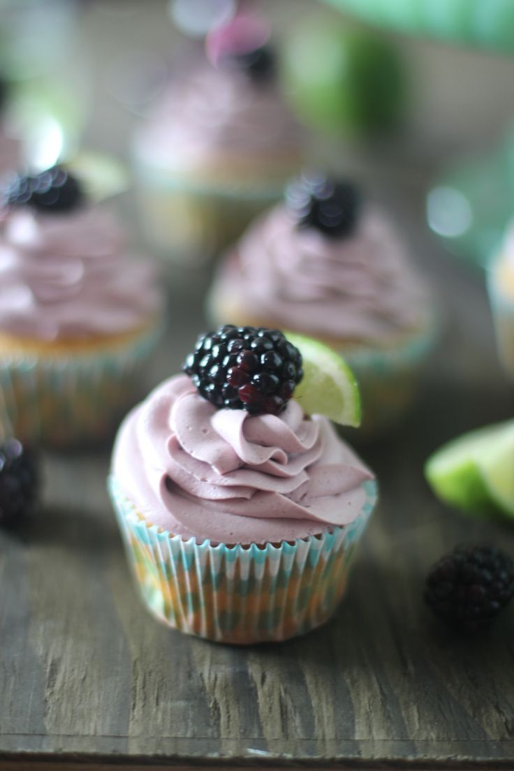 Soft lime cupcakes topped with a sweet blackberry cream cheese frosting - the perfect spring or Easter treat! | #lime #cupcakerecipes #cupcakes #blackberry #easter | See more delicious recipes at TheSeasideBaker.com