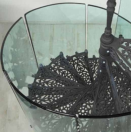 wrought iron spiral stair with glass rail