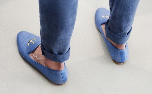 Blue nautical slippers shoes with anchors no socks spotted backstage at Oscar de le Renta.