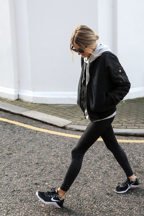 black men's jacket, grey hoodie, black leggings, nike sneakers, low messy bun, sunnies, black handbag