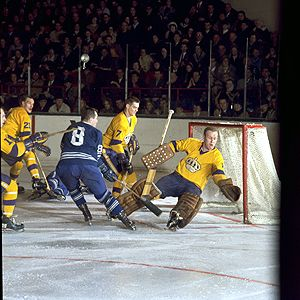 RON ELLIS IS THWARTED (ABOVE) ON A GREAT SCORING CHANCE BY GOALIE WAYNE RUTLEDGE OF THE LOS ANGELES KINGS - THIS PHOTO FROM A MAR. 2, 1968 ENCOUNTER AT THE GARDENS. BILL WHITE (21) AND REAL LEMIEUX (7) ARE THE OTHER LOS ANGELES PLAYERS.