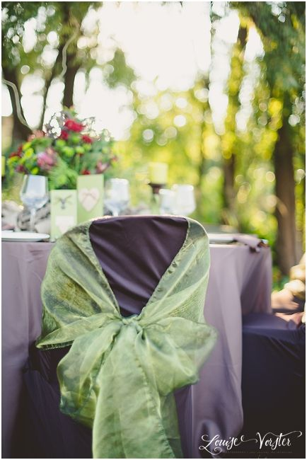 A close up the brown chair covers and the green organza chair covers.