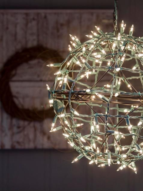 Turn old hanging baskets into festive light balls for your porch or patio.