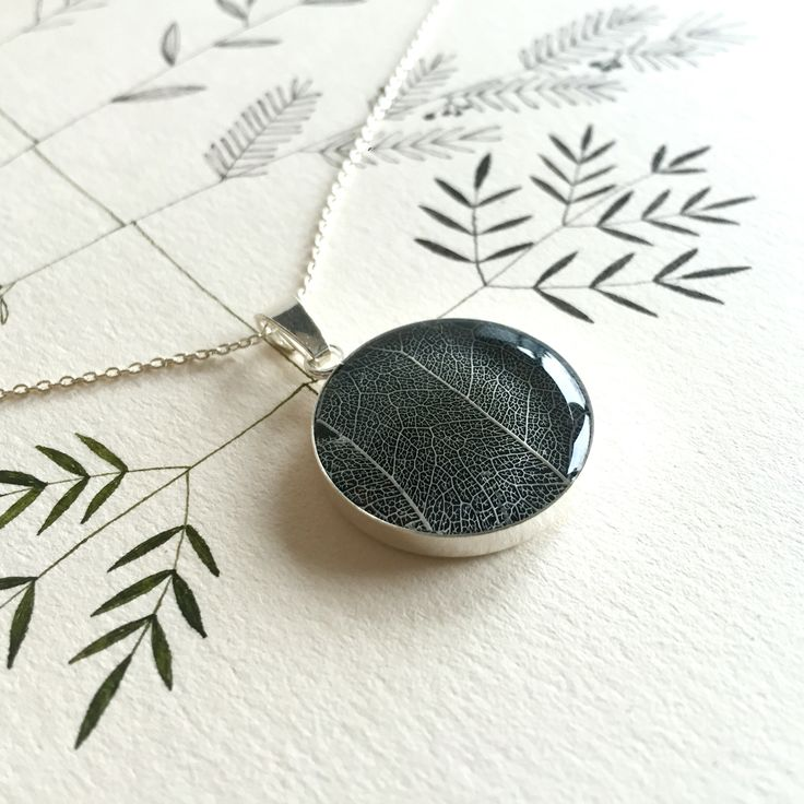 Tilia tomentosa veins preserved in resin in a 925 sterling silver pendant. By Pebs
