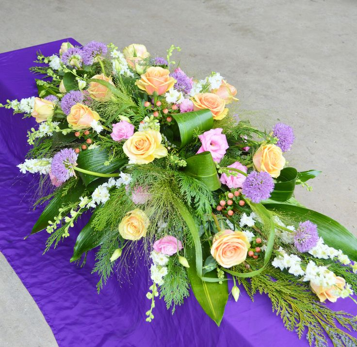 A large 5' double ended spray of seasonal flowers.
