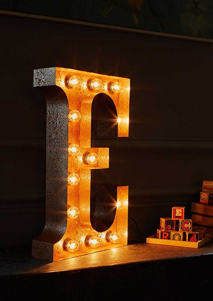 This large metal letter E lamp with its exposed bulbs and warm glow will add a rustic charm to any room. View Lime Lace for other letters of the alphabet.