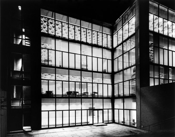 YUAG—Kahn Building, 1953. New window scrims control light, yet retain the building's translucency. When needed, blackout curtains offer total control of daylight.