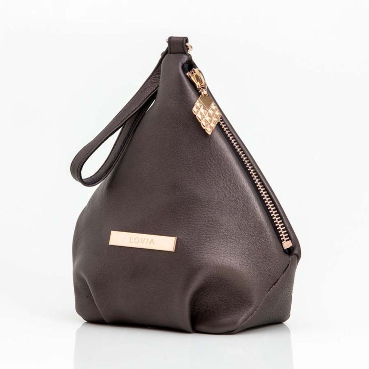 Wristlet diamond bag made of fine elk leather. This both sustainable and elegant bag is diamond shaped & inspired by the Lovia diamond cone.