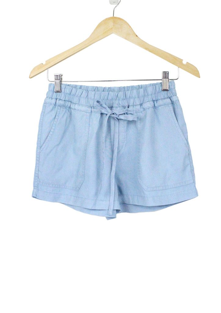 This baby-blue lightweight loose shorts featuring an elasticized waist with drawstring and slanted front pockets is perfect for your warm-weathered fun days.  Rock in this unique classic piece with a pair of ankle-strap sandals!  <Summer Outfits>