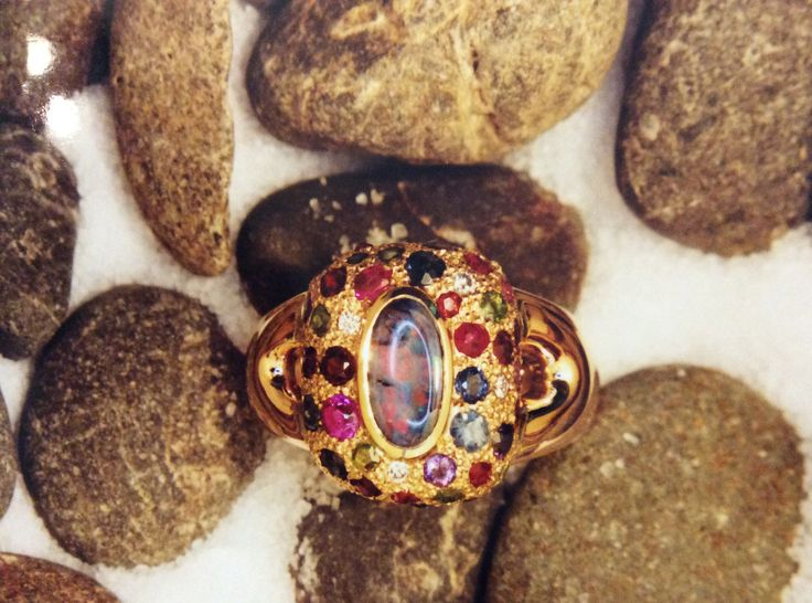 Water opal pillow cluster surrounded by an eclectic mix of colourful  semi precious stones in yellow gold