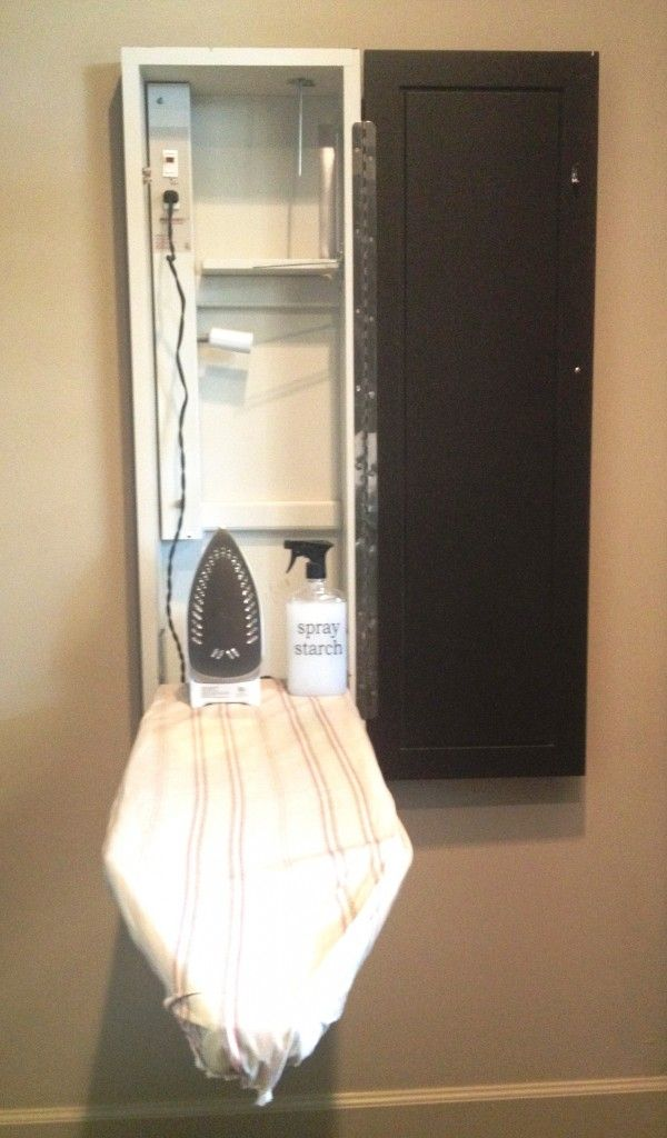 Ironing board cupboard with integrated electrical for laundry room or even master bathroom