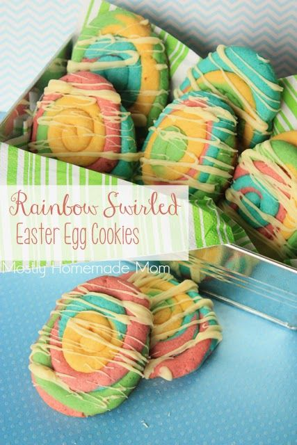 Simple colored sugar cookies swirled into an egg shape and drizzled with white chocolate. Such a great way to celebrate Easter!