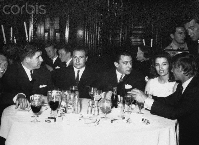 1964. Ronnie Kray with Christine Keeler & at right Leslie Holt. Corbis images.