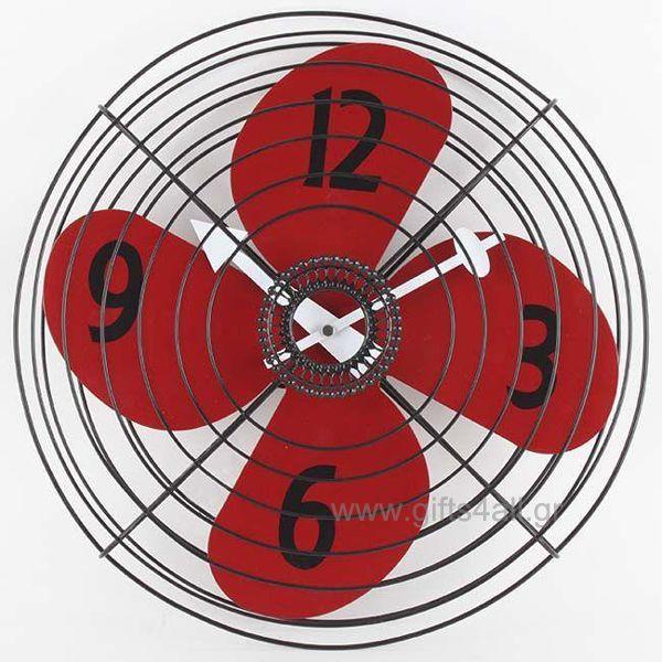Μεταλλικό ρολόι τοίχου σε σχήμα ανεμιστήρα, τα μεταλλικά φτερά του ανεμιστήρα είναι στο κόκκινο χρώμα που δείχνει τους αριθμούς ενώ με το άσπρο χρώμα είναι οι δείκτες. Η διάμετρος του ρολογιού είναι στα 35 εκ. Ιδανικό δώρο για την κουζίνα σας ή τον διάδρομο του σπιτιού σας.
