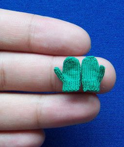 Tiny Mittens knit with sewing thread.