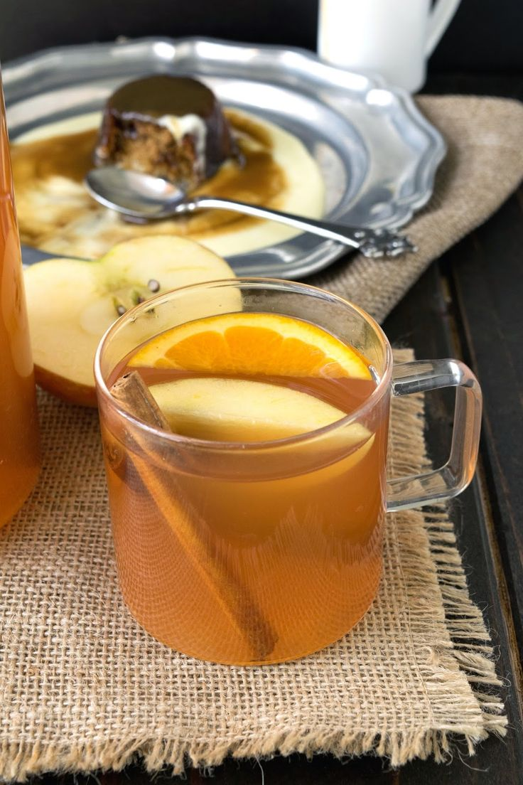 Homemade hot apple cider using fresh and sweet honey crisp apples, juiced then simmered with cinnamon sticks, orange wedges and nutmeg.