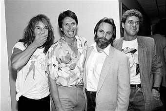 Singer David Lee Roth of Van Halen with comedian David Brenner, Carl Wilson of the Beach Boys and comedian Joe Piscopo on David Brenner's radio show in New York City on July 17, 1985.