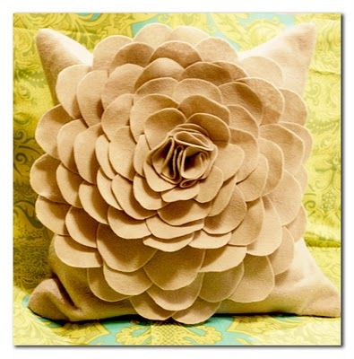 DIY Felt Flower Pillow; cut a bunch of different sized half circles.  For the middle, fold/scrunch three circles together.  Hot glue or sew! Totally doing this!
