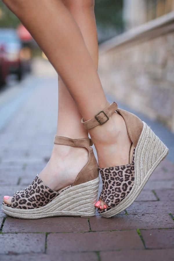 8e8ef94c9bba Cheetah print, peep-toe wedges with adjustable ankle strap closure. These  wedges feature a braided jute heel. Man-made materials Approx.