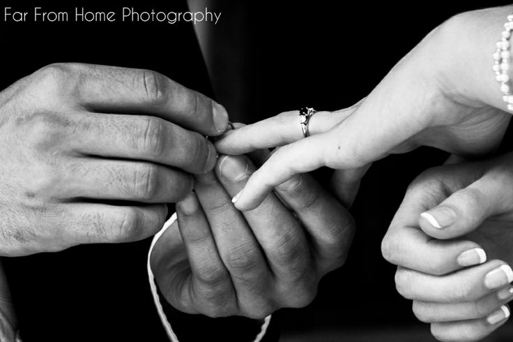 The giving of rings at Mr & Mrs Sallis' Wedding