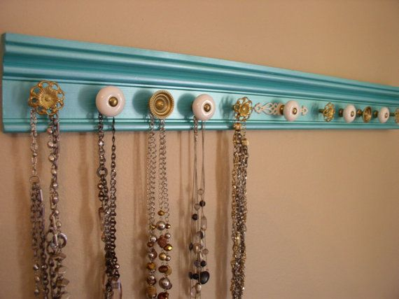 """jewelry organizer .This necklace organizer has 11 decorative cabinet knobs metallic finish EXTRa LONg 30 """" plenty of necklace display room"""
