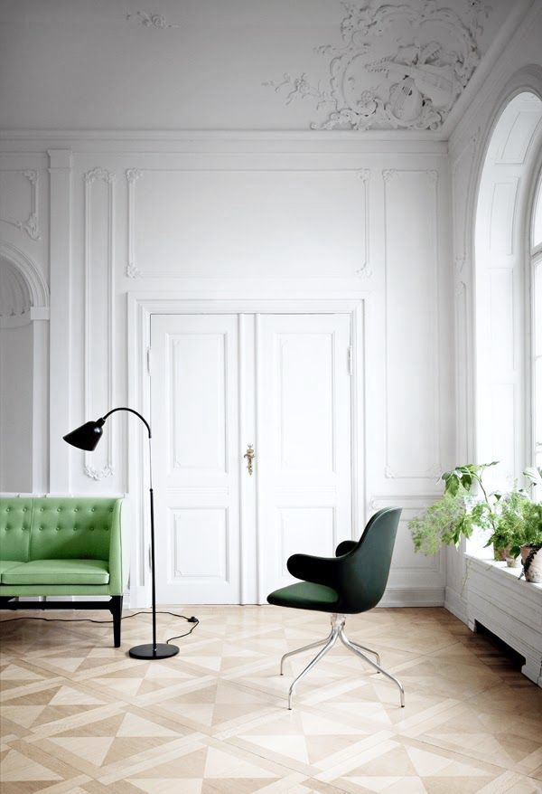 Gorgeous Parisian apartment. with green sofa.