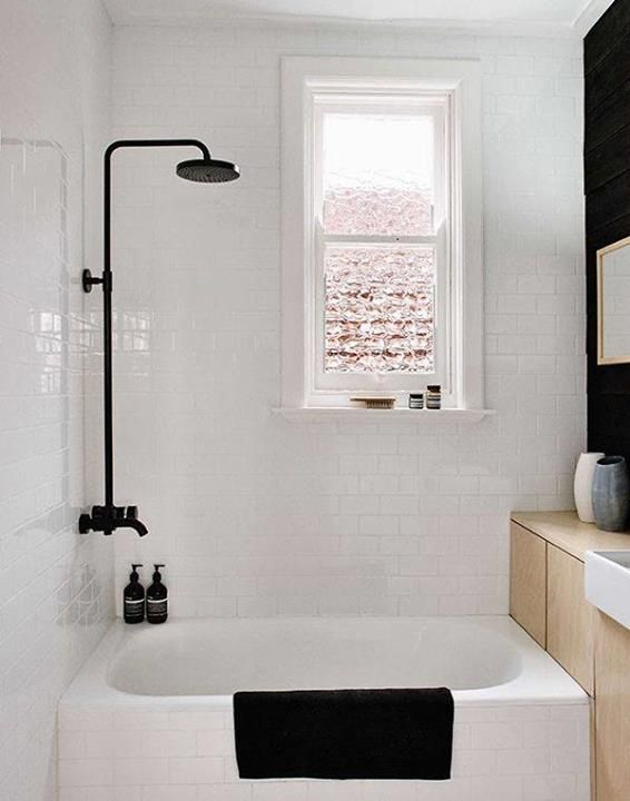 : White Tile, Shower Head, Small Bathroom, Showerhead, Black And White, Subway Tile, Black Shower, Bathroom Ideas, White Bathroom