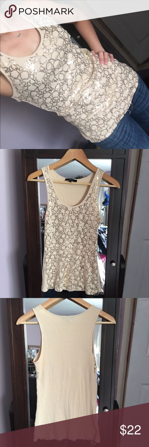 Express gold sequin tank top Express gold sequin tank top. Cute and flirty for a day out. Sz S true to sz. No damage great condition. Feel free to message me with any questions. Any reasonable offers is accepted Express Tops Tank Tops