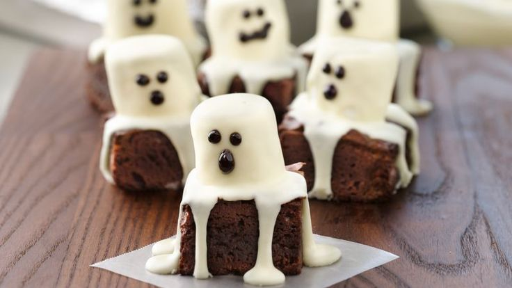 """Spooky Boo Brownies. """"Spooktacular"""" fun and scrumptious eating are coming your way! Gather your goblins to share lots of baking tricks and treats like these adorable Boo Brownies."""
