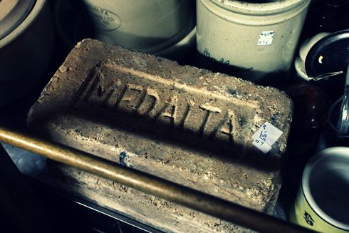 Brick with the name MEDALTA pressed into it  | Editing Luke