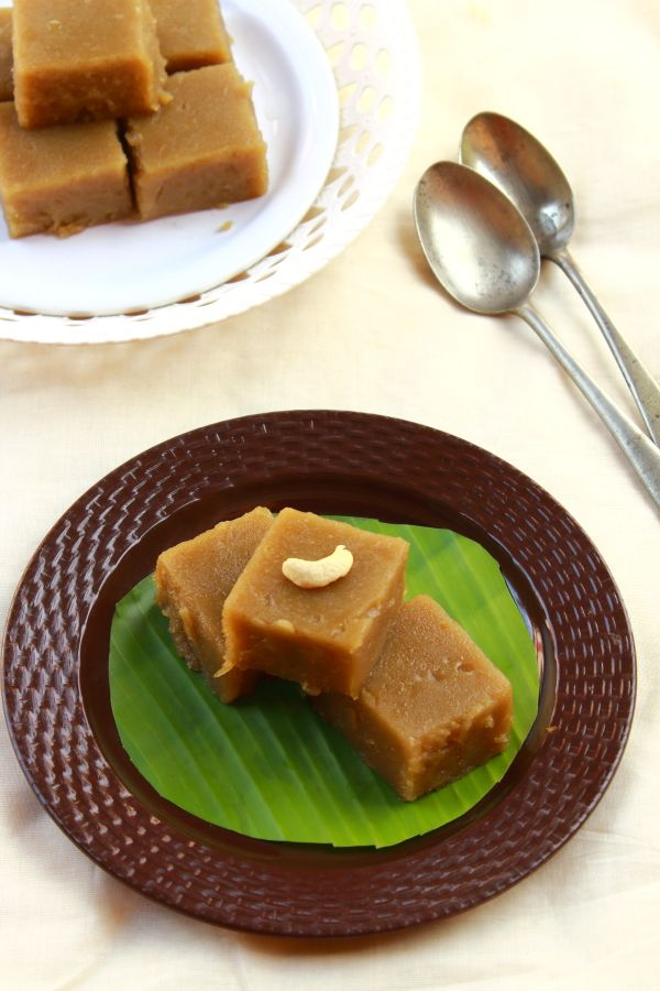 kerala style rice halwa recipe with coconut milk. kerala style black halwa is very famous and can be made at home with rice, jaggery, coconut and ghee