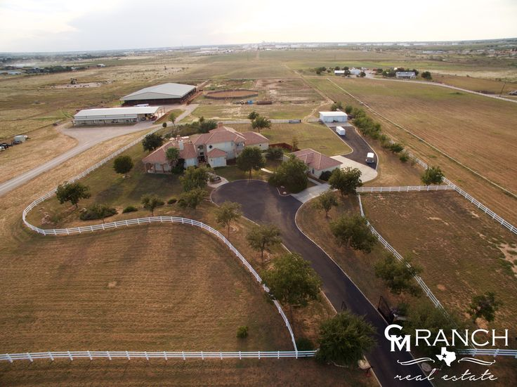 FOR SALE - The 5T Cutting Horse Farm is truly an equestrian's dream come true. This incredible property is located on 72+ fenced acres in Midland County with a large 25,000+/- square-foot covered arena, round pen, 20+ stalls, vet room complete with an office, kitchen, bath, washer/dryer, wash rack, workshop, three luxurious apartments with granite, a six-horse equicizer walker with timing controls, and an alluring 5,600+ square-foot Mediterranean-style main house.