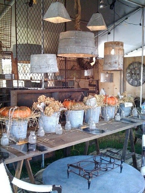 Old tubs or containers turned upside down into rustic lamp shades. These would be perfect for a country style kitchen.