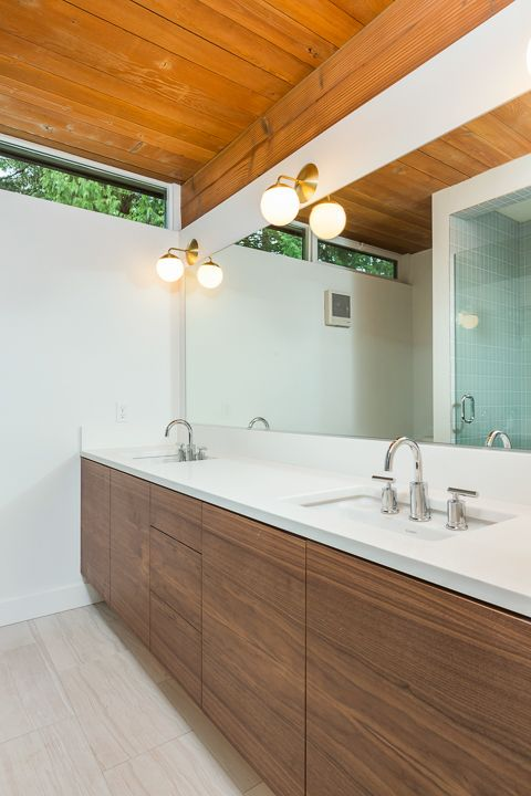Cedar & Moss Alto Sconces light this restored mid-century forest home in Portland, OR. Love the mixed finishes in this bathroom | Teal Davison Design + Finish