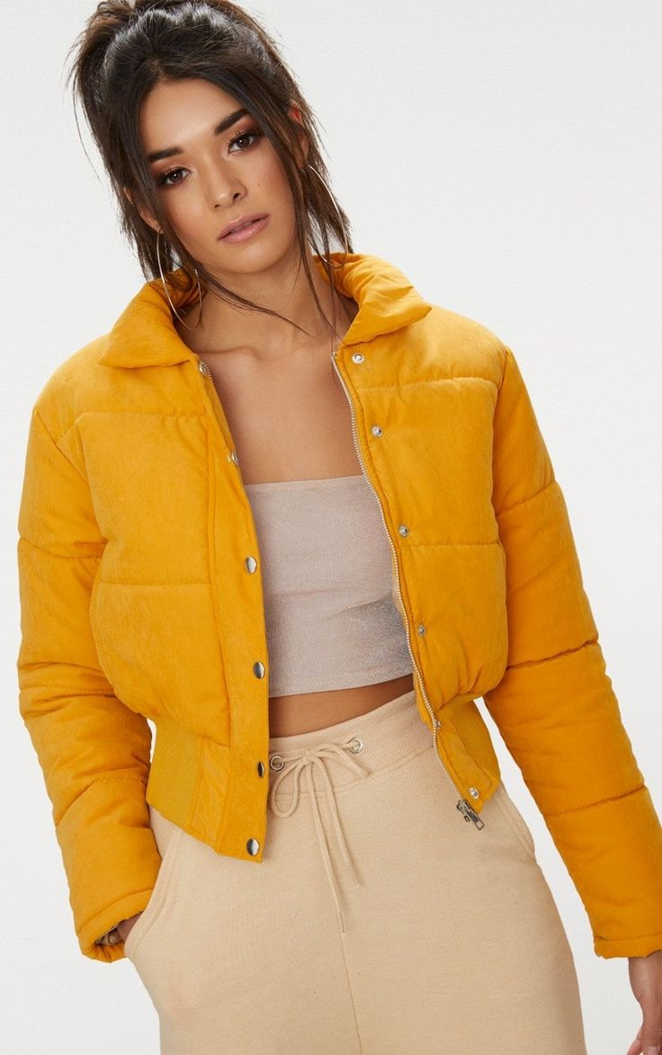 Mustard Peach Skin Cropped Puffer JacketThis mustard puffer jacket is a total wardrobe staple thi...