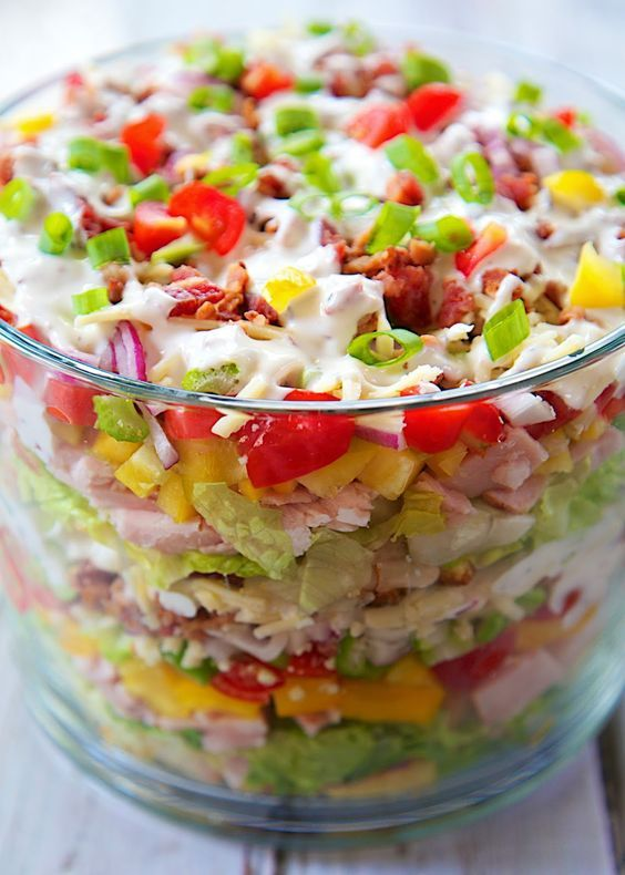 Cornbread & Turkey Layered Salad Recipe - loaded with cornbread turkey cheese vegetables and bacon! It is a whole meal in one big bowl! Make ahead of time and refrigerate before serving. Can be made 24 hours in advance. Perfect for brunch/lunch.
