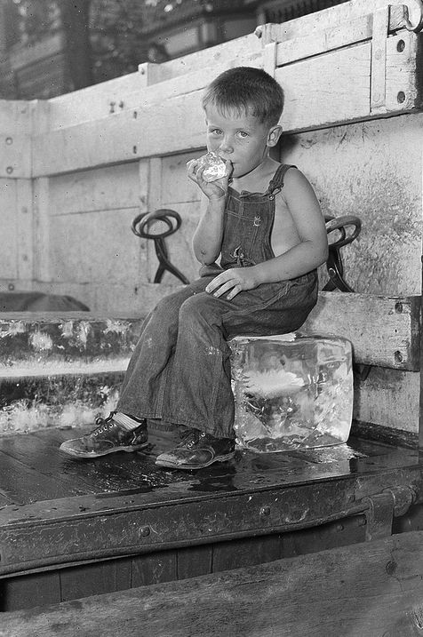 +~+~ Vintage Photograph ~+~+  Summertime and a boy cools off on an ice truck.  Boston ~ 1937.