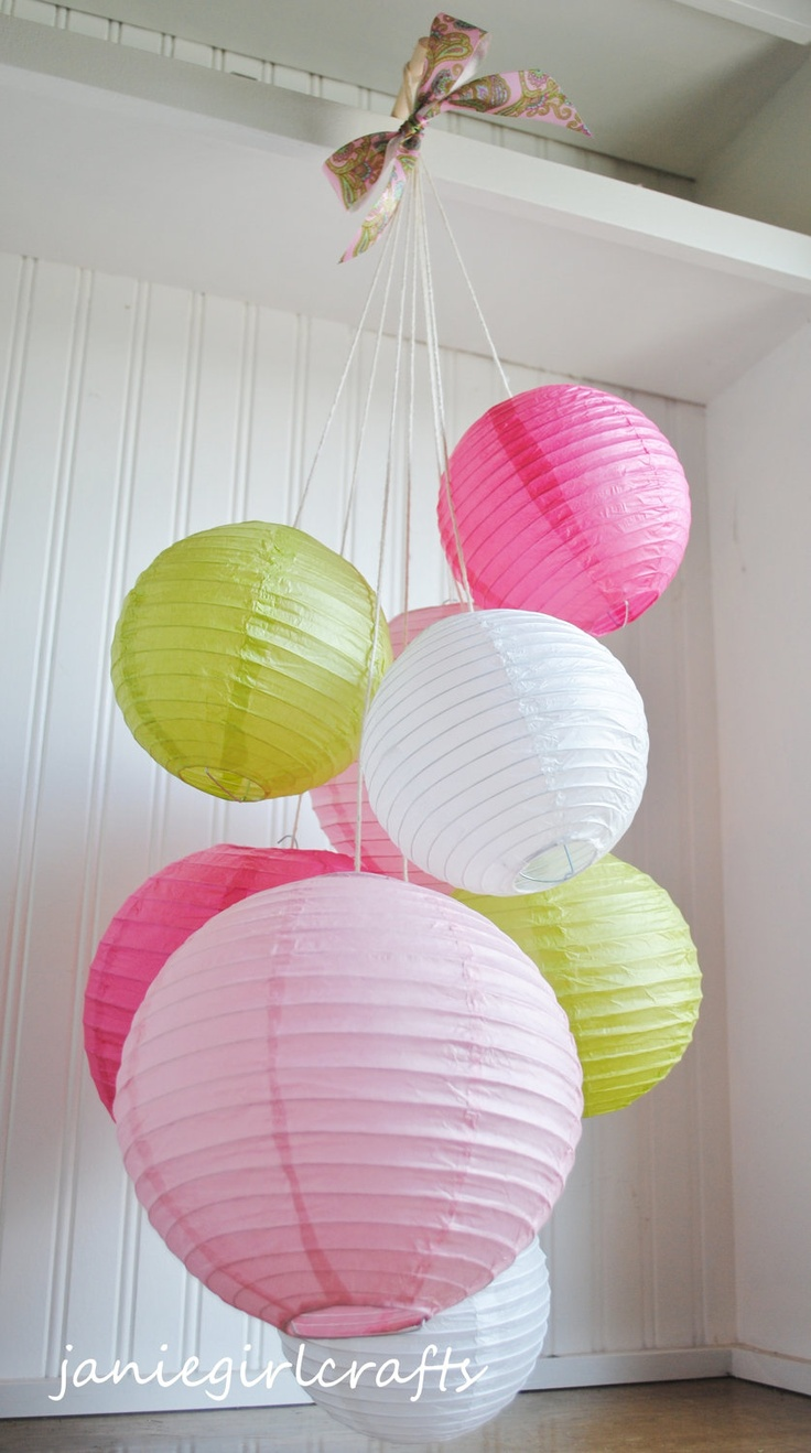 Love the way that these are hung! Pinks White and Chartreuse Paper Lantern by janiegirlcrafts, via Etsy.
