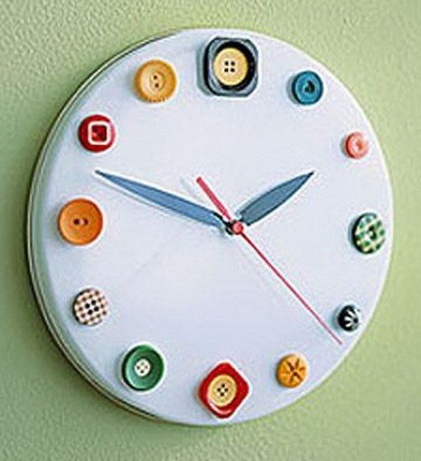 Button clock made out of a cookie tin lid, buttons, and clock parts. It is a great idea to help kids learn to read time. http://hative.com/diy-wall-clock-ideas-for-decoration/