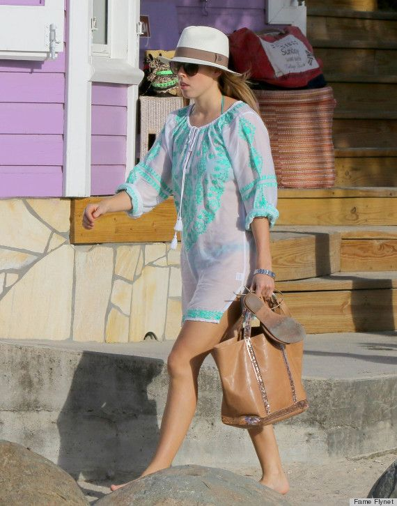 Princess Beatrice in St Barts this week looking very chic.  Get the look with our Turquoise and White Hand-Embroidered Beach Cover-up www.beachcover.com