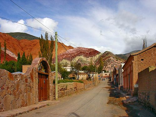 Quebrada de Humahuaca (Argentina). 'This spectacular valley of scoured rock impresses visually with its tortured formations and artist's palette of mineral colors, but is also of great cultural interest. The Quebrada's settlements are traditional and indigenous in character, with typical Andean dishes supplanting steaks on the restaurant menus, and llamas, not herds of cattle, grazing the sparse highland grass.' http://www.lonelyplanet.com/argentina/northwest-argentina/quebrada-de-humahuaca