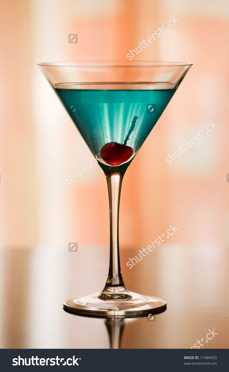 Betty Blue Cocktail. Short drink to serve at any time. Ingredients: 5-6 ice cubes, 1 vodka, 1/3 peach schnapps, 1/3 dry vermouth, 2-3 drops blue curacao, 1 maraschino cherry