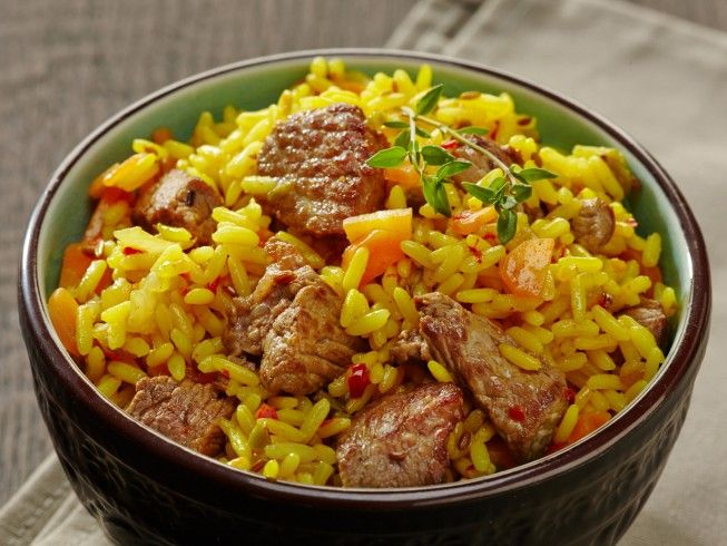 A 5-star recipe for Plov made with olive oil, vegetable oil, lamb shoulder, carrots, onions, hot Hungarian paprika powder