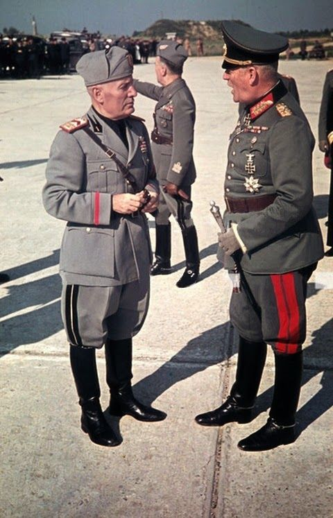 Il Duce Benito Mussolini speaking with Generalfeldmarschall Wilhelm Keitel (Chef des Oberkommando der Wehrmacht) at Feltre airfield (Northern Italy) before Keitel leaves for Berlin. The picture was made by Walter Frentz in the evening of 19 July 1943.