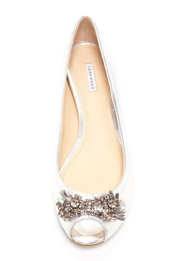 Look for these shoes high and low for my wedding...Vera Wang Lavender Lanie Peep Toe Flat