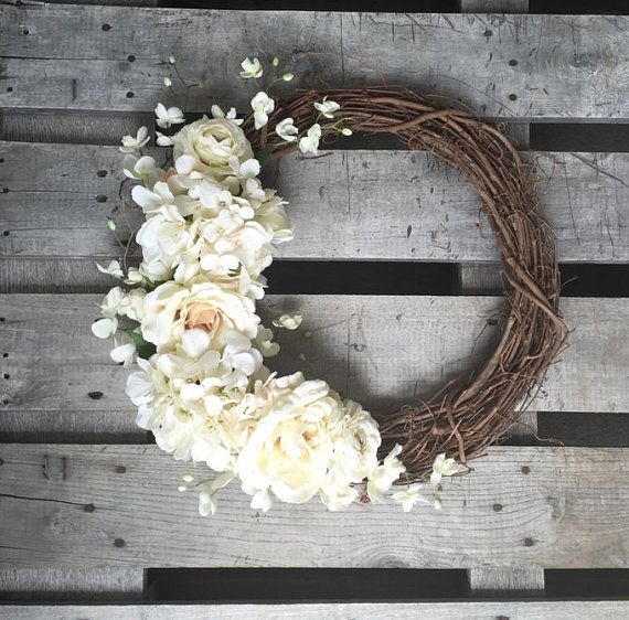 A rustic white wreath perfect for any occasion!  This item is an 18 Grapevine wreath with beautiful white flowers. Great for Weddings, Spring,