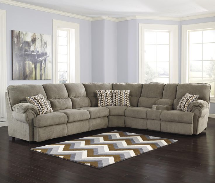 Signature design by ashley comfort commandor mocha for Sectional sofa with recliner and queen sleeper